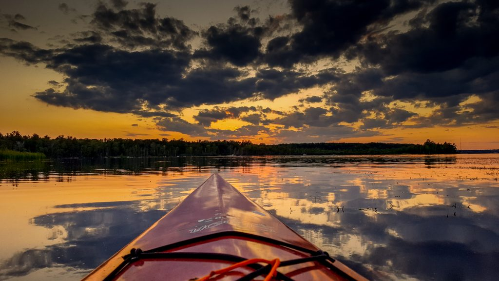 Sunset over the Bow of the Kayak