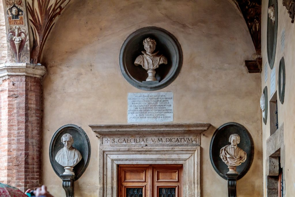 Protected under the arch at Palazzo Chigi Saracini